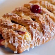 "Cherry Cheese Lattice Coffee Cake | A sweet bread dough filled with cream cheese and cherries, ""braided"" and baked until it's golden brown, then finished with sweet icing drizzled prettily over the bread. Find recipe at redstaryeast.com."