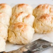 Gluten Free Pani Popo Recipe (Polynesian Coconut Rolls) | Fluffy, soft gluten-free rolls baked in a sweet coconut milk syrup. Find recipe at redstaryeast.com.