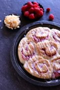 Raspberry Coconut Sweet Rolls | Soft and fluffy sweet rolls with a jammy raspberry filling and coconut glaze. Find recipe at redstaryeast.com.