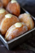 Meyer Lemon Cream Doughnuts | Airy yeast doughnuts, rolled in sugar and then filled with a creamy, tart Meyer lemon filling. Find recipe at redstaryeast.com.