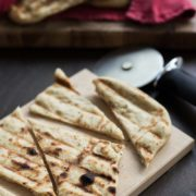 Grilled Roasted Garlic & Herb Flatbreads | These flatbreads are the perfect accompaniment to your fresh summer favorites. They pair well with a variety of salads, grilled vegetables, and even meat and vegetable skewers. Just bake directly on the grill, right alongside of the rest of your dinner. It couldn't be simpler! Find recipe at redstaryeast.com.