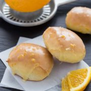 Baked Brown Butter Beignets | Nothing can compare to soft baked brown butter beignets topped with a sweet orange brown butter glaze. There's big flavor in these bite-sized treats! Find recipe at redstaryeast.com.
