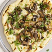Grilled Mushroom Pizza with Rosemary and Smoked Mozzarella | Fresh and flavorful with a soft and chewy homemade crust, this grilled pizza is the perfect recipe for summer. Find recipe at redstaryeast.com.