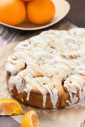 Slow Cooker Orange Sweet Rolls | These are the best orange sweet rolls – soft, light, fluffy, with a hint of cinnamon orange flavor. Topped with a bold orange glaze, they're completely irresistible. The dough is simple and doesn't require time for rising because it all happens in the slow cooker. This is the easiest and most delicious sweet roll recipe ever! Find recipe at redstaryeast.com.
