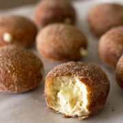 Maple Vanilla Stuffed Chai Doughnuts | There is nothing better for a weekend breakfast than fluffy chai-spiced yeast doughnuts filled with a homemade maple vanilla bean cream. Make these easy doughnuts for a fun baking project! Find recipe at redstaryeast.com.