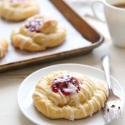 Spiced Cranberry Orange Danishes | Buttery pastry scented with cinnamon and orange zest and filled with cranberry sauce. A perfect wintertime morning treat! Find recipe at redstaryeast.com.