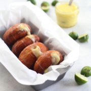 Key Lime Doughnuts are crisp, fluffy, yeasted doughnuts filled with a tart key lime curd and topped with a sugary sweet glaze. The perfect balance of tart and sweet, these are fun to make and a delicious, decadent treat! Find recipe at redstaryeast.com.