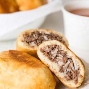 Russian Piroshki (Meat Hand Pies) | Perfect for picnics, potlucks and any summer activities, these Russian piroshki (meat hand pies) are made of tender and soft dough, filled with simple meat and rice mixture and fried till crisp golden perfection! Find recipe at redstaryeast.com.