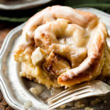 Apple Cinnamon Rolls | Gooey cinnamon rolls bursting with chopped apples and topped with a sweet caramel icing for a delicious breakfast treat. Find recipe at redstaryeast.com.