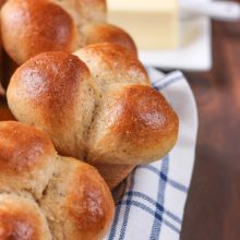 45 Minute Herbed Wheat Cloverleaf Rolls | These Herbed Wheat Cloverleaf Rolls are perfectly light and fluffy while only taking 45 minutes to make from start to finish! A light, savory herb flavor gives these dinner rolls a unique flavor perfect for pairing with soups, chicken, and, of course, Thanksgiving dinner! Find recipe at redstaryeast.com.