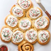 Cinnamon Roll Christmas Tree | These fun and festive cinnamon rolls baked up in the shape of a Christmas tree are perfect for the holidays! Find recipe at redstaryeast.com.