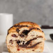 Chocolate Swirl Bread with Cherries | Chocolate Swirl Bread with Cherries is a tender yeast bread dotted with cherries that's braided with swirls of melty chocolate and baked to golden perfection! Find recipe at redstaryeast.com.