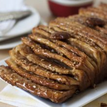Whole Wheat Caramel & Pecan Pull-Apart Bread | Irresistible, sweet, buttery pull-apart bread layered with cinnamon brown sugar and crushed pecans, baked until it's golden brown and drizzled with a sweet salted caramel sauce. Find recipe at redstaryeast.com.