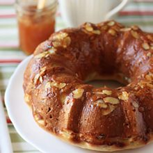 Apricot Glazed Coffee Cake | A rich cake-like yeast bread flavored with lemon rind, fruits and almonds that is reminiscent of the Austrian Guglehupf. This special holiday coffeecake glistens with a glaze of apricot preserves. Find recipe at redstaryeast.com.