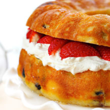 Baba Au Rhum with Strawberries & Whipped Cream | A rich, no knead yeast cake, baked in a bundt pan and soaked with a rum flavored sugar syrup. Find recipe at redstaryeast.com.