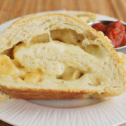 Cheese Stromboli | Each slice of this loaf reveals a savory spiral of cheese and herbs. Find recipe at redstaryeast.com.
