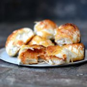 Cheesy Pizza Rolls | Chewy pizza dough made into dinner rolls, filled with extra cheese, sauce and any of your favorite pizza toppings. Find recipe at redstaryeast.com.