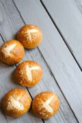 Chewy Prezel Buns | This easy recipe for chewy, flavorful pretzel buns will wow the entire family. Serve them with dinner or use as a sandwich roll! Find recipe at redstaryeast.com.
