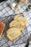 Garlic and Herb Swirled Bread | Fluffy yeast bread swirled around salted butter, garlic, and herbs. Find recipe at redstaryeast.com.