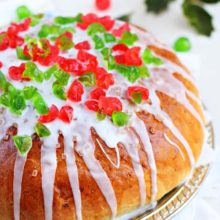 Julekage | Julekage (pronounced yoo-ley-key-yeh) is a popular Norwegian Christmas fruit bread filled with candied fruit, golden raisins and cardamom. Glistening sugar and snow-white icing top this special holiday bread. Find recipe at redstaryeast.com.