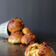 Macaroni & Cheese Stuffed Pretzel Bites with Bacon | Chewy pretzel bites are stuffed with a creamy mac n' cheese and topped with crispy bacon crumbs. Find recipe at redstaryeast.com.