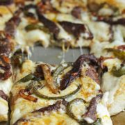 Philly Cheesesteak Pizza | The famous Philly Cheesesteak gets a delicious and fun Italian update! This will become your new favorite on pizza nights! Find recipe at redstaryeast.com.