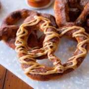 Pumpkin Praline Soft Pretzels | Pumpkin-spiced pretzels, baked to soft perfection, and covered in a brown sugar pumpkin praline glaze. Find recipe at redstaryeast.com.