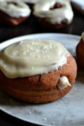 Pumpkin Yeast Doughnuts | Deep fried pumpkin yeast doughnuts, filled with cinnamon cream cheese frosting and topped with a sea salted maple glaze. Find recipe at redstaryeast.com.