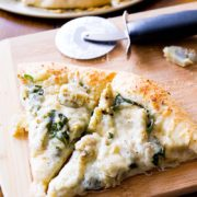 Spinach Artichoke White Cheese Pizza | Thick style homemade pizza crust topped with garlic, two cheeses, artichokes, and spinach. Like spinach artichoke dip, but better. If that's even possible! Find recipe at redstaryeast.com.