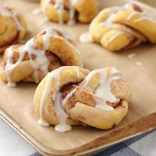 Pumpkin Spice Cinnamon Knots | Soft, tender pumpkin cinnamon knots topped with a sweet maple drizzle! Find recipe at redstaryeast.com.