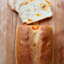 Cheddar-Chunk and Chive Bread | This savory bread is studded with chunks of cheddar cheese. Try it with your favorite sandwich meats or BLTs. Find recipe at redstaryeast.com.