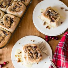 Gluten Free Pecan Cranberry Sweet Rolls | Tender, sweet rolls filled with pecan frangipane and chopped dried cranberries, drizzled with a white chocolate glaze. Find recipe at redstaryeast.com.