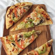 Ultimate Veggie Flatbreads | Homemade flatbread has never been easier or more delicious. This ultimate veggie flatbread has a flavorful crispy crust and lots of fresh veggie goodness on top. Find recipe at redstaryeast.com.