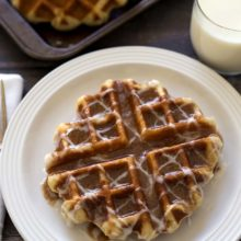 Cinnamon Roll Liege Waffles | A rich, buttery waffle with a sweet, crisp caramelized exterior served cinnamon roll style with a sweet cinnamon butter and a pretty icing drizzle. Find recipe at redstaryeast.com.