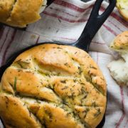 Rosemary and Sea Salt Focaccia | Soft and chewy focaccia bread, loaded with fresh chopped rosemary and lots of good quality extra virgin olive oil! Use this bread for sandwiches, or just dip it in some balsamic vinegar for the perfect appetizer. Find recipe at redstaryeast.com.