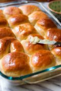 Honey Butter Dinner Rolls | Soft and fluffy dinner rolls infused with sweet honey and topped with homemade honey butter right after baking. They're absolutely a must for your dinner menu! Find recipe at redstaryeast.com.