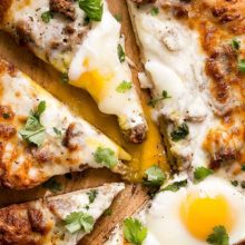 Sausage and Egg Breakfast Pizza | An easy and tasty spin on an original pizza. Sausage, egg and melted cheese on top of the best pizza dough. Make this for brunch or breakfast and add fresh cilantro. Find recipe at redstaryeast.com.