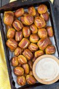 Lemon Poppy Seed Soft Pretzel Bites | There's nothing like a soft, chewy pretzel bite to curb your snack cravings. These lemon poppy seed soft pretzel bites are perfectly bite-sized and are extra delicious when dipped in a cool, creamy honey yogurt sauce. Find recipe at redstaryeast.com.