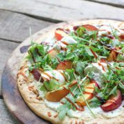 Pickled Stone Fruit Pizza | Golden dough topped with creamy ricotta, pickled peaches and plums, pepper arugula and fresh burrata. A drizzle of balsamic reduction is the perfect finishing touch to this summer pizza recipe. Find recipe at redstaryeast.com.