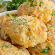 Cheddar Bay Drop Biscuits are full of flavor and light as air. These are inspired by your favorite Red Lobster Biscuits Recipe with cheddar cheese, buttermilk, fresh parsley and Old Bay Seasoning. Perfect for a quick dinner side dish or holiday feasts! Find recipe at redstaryeast.com.