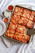 Sheet Pan Pizza | This sheet pan pizza recipe is so incredibly delicious and perfect for feeding a crowd. The crust has a wonderful crispy outside and soft inside and makes the perfect party food that all your guests will enjoy! Find recipe at redstaryeast.com.