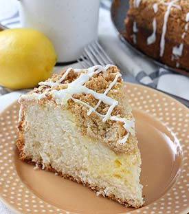 Cream Cheese Swirled Coffee Cake | This easy cream cheese swirled lemon coffee cake has a light, airy texture, a hearty crumb topping, and a sweet lemon cream cheese swirl! Find recipe at redstaryeast.com.
