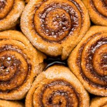 {Healthy} Pumpkin Spice Latte Cinnamon Rolls | These cinnamon rolls taste like the iconic autumn drink! Tender pumpkin dough flavored with coffee and filled with gooey cinnamon spirals—what's not to love?? Find recipe at redstaryeast.com.