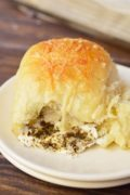 Pesto Mozzarella Stuffed Dinner Rolls | These Pesto Mozzarella Stuffed Dinner Rolls are not only great for a holiday recipe, they are fantastic year round! You can't go wrong with fresh mozzarella and flavorful basil pesto tucked inside these super soft yeast rolls! Find recipe at redstaryeast.com.