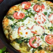 Skillet Pizza with Pesto, Tomatoes & Spinach | Homemade pizza pie dough made in cast iron skillet with fresh pesto, tomato, and spinach toppings. Ready for Friday pizza night with these garden-fresh ingredients. Find recipe at redstaryeast.com.