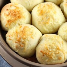 White Cheddar Potato Rolls | White Cheddar Potato Rolls are a delicious dinner roll that is perfect for holidays and special get-togethers. Topped with tangy white cheddar cheese before baking to create a crunchy crust with a light and fluffy center. Find recipe at redstaryeast.com.