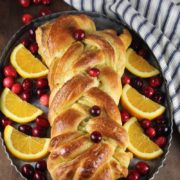 Orange Cardamom Braided Bread | Impress your friends, family and neighbors with this beautiful Orange Cardamom Braided Bread. Garnish with fresh cranberries and fresh orange slices for the holidays. Find recipe at redstaryeast.com.