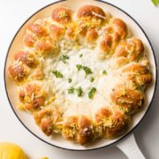 Lemon Roll Wreath with Gorgonzola Dip | Fluffy lemon yeast rolls shaped in a wreath with a hot Gorgonzola cheese dip - all baked together for a quick and easy appetizer. Find recipe at redstaryeast.com.