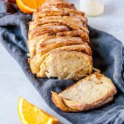 Vegan Orange Cinnamon Pull- Apart Bread | Vegan pull-apart bread that is SO fluffy and perfect, packed with fresh orange flavor, cinnamon, and the BEST sweet orange glaze! Find recipe at redstaryeast.com.