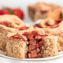 Healthy Strawberry Cinnamon Rolls | With their juicy fresh berry filling, these cinnamon rolls are perfect for spring and summer brunches! The dough is light and tender, and the fruit filling is such a fun twist on classic cinnamon rolls. Find recipe at redstaryeast.com.